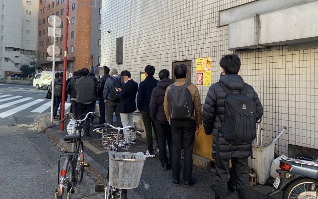 People lining up to the back of Ramen Jiro